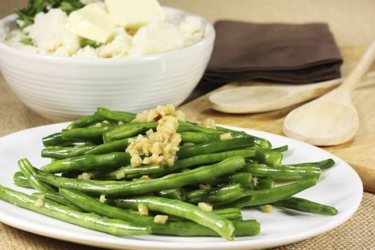 This quick and easy side dish of French green beans, shallots, and pine nuts is perfect for weeknight dinners. Pair with pan-seared chicken or baked pork chops. .