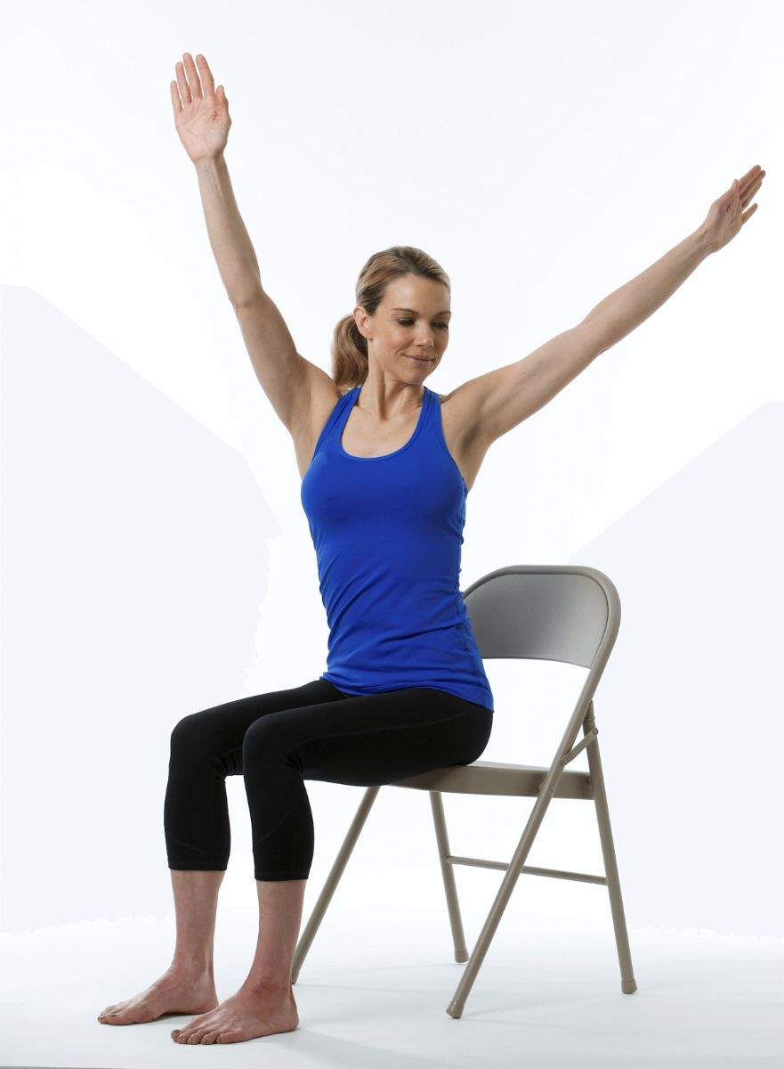 Release Stress Right at Your Desk With 5 Chair Yoga Moves ...